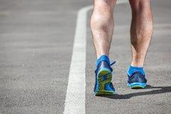 Runner feet running on stadium Stock Images