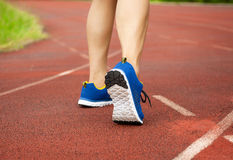 Runner feet running on track. workout wellness concept Stock Photos