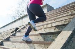 Runner feet running upstairs closeup on sneakers Stock Photography