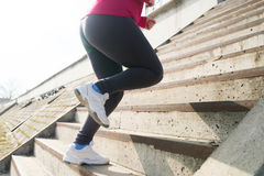 Runner feet running upstairs closeup on sneakers Stock Image