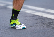 Runner feet and shoe. Hair on the leg. Royalty Free Stock Images
