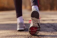 Runner feet with sport shoes on road Stock Photos