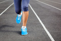 Runner Feet on Stadium Closeup. Royalty Free Stock Images