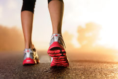Runner feet sunrise Royalty Free Stock Photography