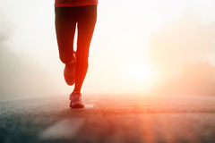Runner feet sunrise Stock Images
