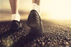 Runner feet at sunrise Stock Photos