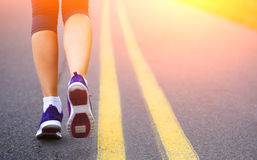 Runner Female Feet Running on Road. Royalty Free Stock Images