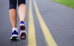 Runner Female Feet Running. On Road. Jog Stock Photos