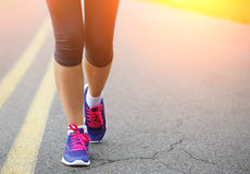 Runner Female Feet Running on Road. Jog Stock Images