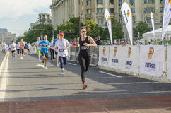 Runner female at finish line Royalty Free Stock Photos