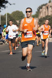 Runner foreground and several runners in background Royalty Free Stock Image