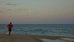Runner on Full Moon at Long Island Beach Royalty Free Stock Photo