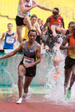 Runner Getahun overcomes obstacles Stock Photos