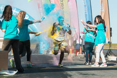 Runner Gets Squirted With Multiple Colors At Color Run Stock Photos