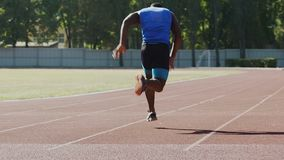 Runner getting on start line, starting run upon command, training for marathon stock video