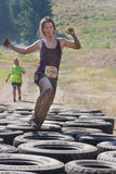 Runner getting through the tires Royalty Free Stock Photos