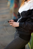 Runner girl with mobile phone, close-up Stock Image