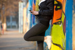 Runner girl with mobile phone, close-up Stock Photography