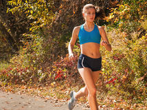 Runner Girl in Park Stock Images