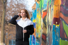 Runner girl putting on earphones Stock Photography
