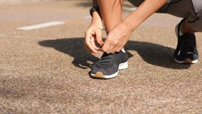 Runner Girl Tying Sneakers Running Shoe Laces in Park. 4K, Slow Motion Close Up. Bangkok, Thailand. Runner Girl Tying Sneakers Running Shoe Laces in Park. 4K stock video