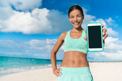 Runner girl using smartphone fitness app Stock Images