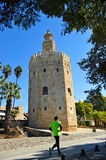 Runner in the Gold Tower, Seville, Spain. The Torre del Oro, Golden Tower, arabic tower of defense in the old port of Seville, Andalusia, Spain Royalty Free Stock Images