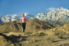 Runner in high mountains Stock Image