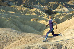 Runner in high mountains Stock Photography