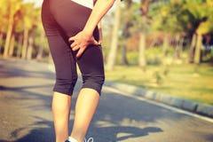 Runner hold her sports injured leg Stock Photography