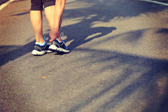 Runner hold her sports injured leg Stock Photo