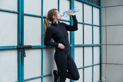 Runner holding a bottle Stock Photo