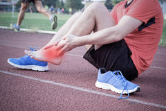 Runner with injured ankle Royalty Free Stock Images
