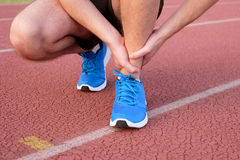 Runner with injured ankle on track Stock Photo