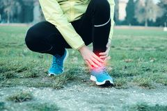 Runner with injured ankle while training Royalty Free Stock Images
