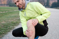 Runner with injured ankle while training Royalty Free Stock Photos