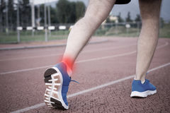 Runner with injured knee on the track Royalty Free Stock Photo