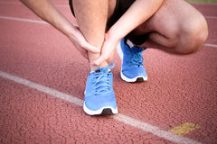 Runner with injured knee on the track Royalty Free Stock Photos