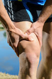Runner Injury. Runner feels muscle pain and grabs the leg Royalty Free Stock Images