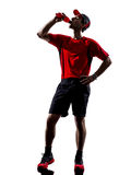 Runner jogger drinking energy drinks silhouette Royalty Free Stock Photography