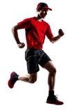 Runner jogger running jogging jumping silhouette Royalty Free Stock Photo