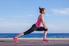 Runner or jogger stretching exercise stock image