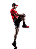 Runner jogger stretching warming up silhouette Royalty Free Stock Image