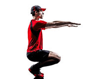 Runner jogger stretching warming up silhouette Stock Images