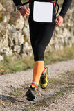 Runner during jogging workout with thesportwear and comfortable. Fast runner during jogging workout with the sports apparel and comfortable sneakers Stock Photos