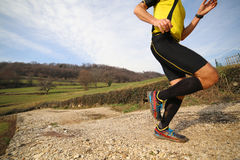 Runner during jogging workout with thesportwear and comfortable. Fast runner during jogging workout with the sports apparel and comfortable sneakers Royalty Free Stock Images