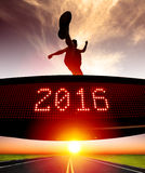 Runner jumping and crossing 2016 display. Young runner jumping and crossing 2016 display Stock Photo