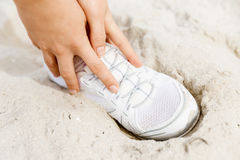 Runner laces his shoes and prepares to jogging. Female runner laces his shoes and prepares to jogging Stock Photos