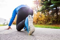 Runner at the lake on asphalt path in steady position. Stock Image