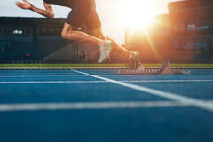 Runner launching off the start line Royalty Free Stock Photo